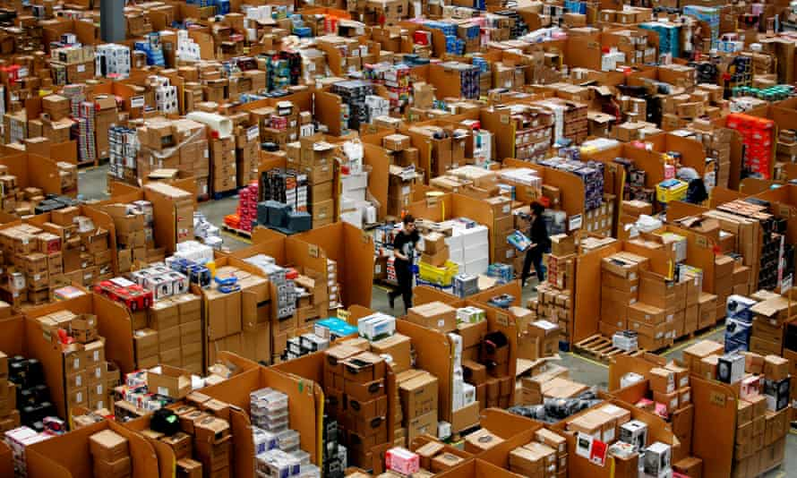 Workers at the Amazon fulfilment centre in Hemel Hempstead, Hertfordshire. The online giant is under pressure to reduce plastic footprint.