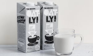 Oatly milk cartons and glass of milk