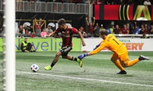 Atlanta United forward Josef Martinez rounds Portland Timbers goalkeeper Jeff Attinella on his way to the opening goal.