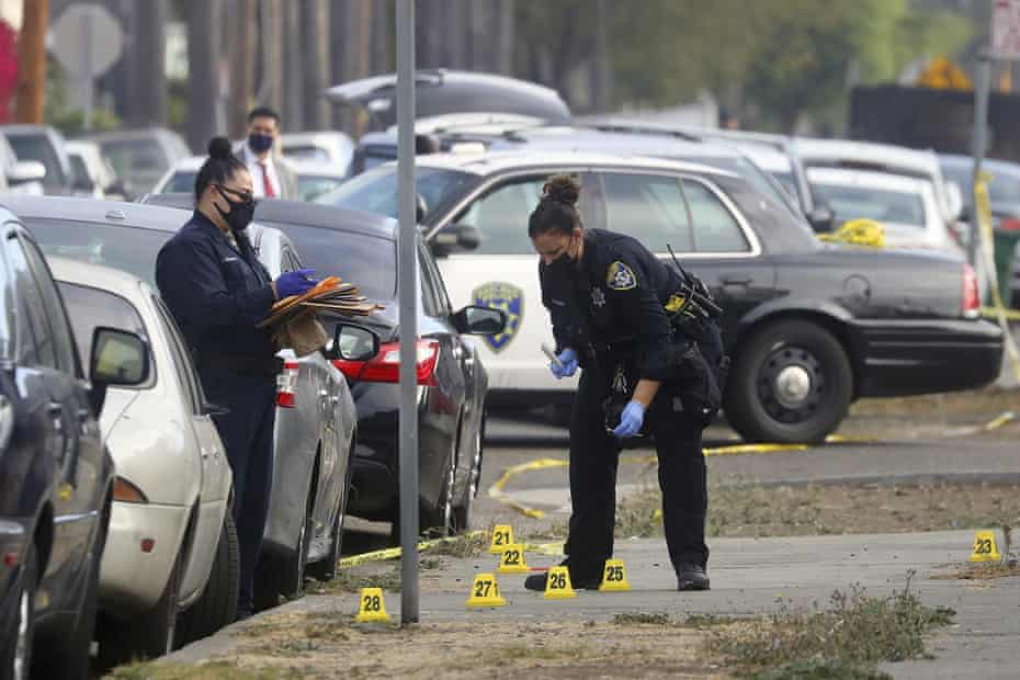 Members of the Oakland police department investigate the scene of an officer-involved shooting on 4 November 2020.