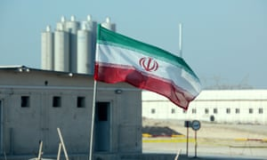 An Iranian flag at Bushehr, Iran's only nuclear power station, during an official ceremony to kick-start works on a second reactor at the facility.