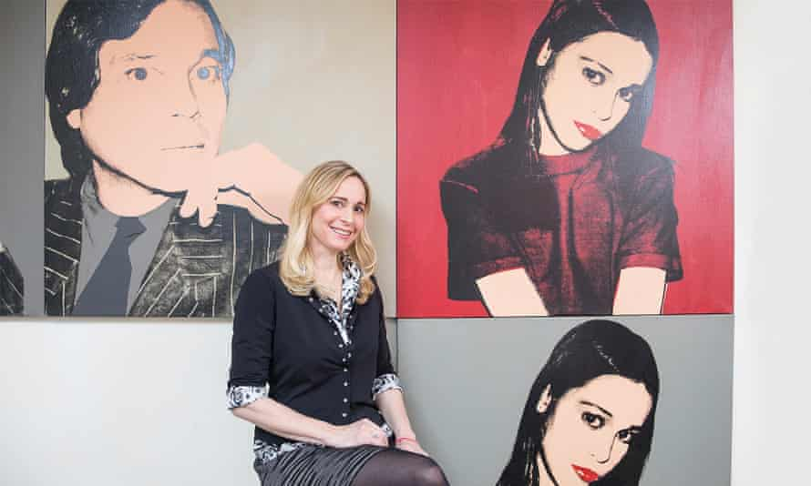 Berkeley Reinhold sitting in front of her portrait by Andy Warhol