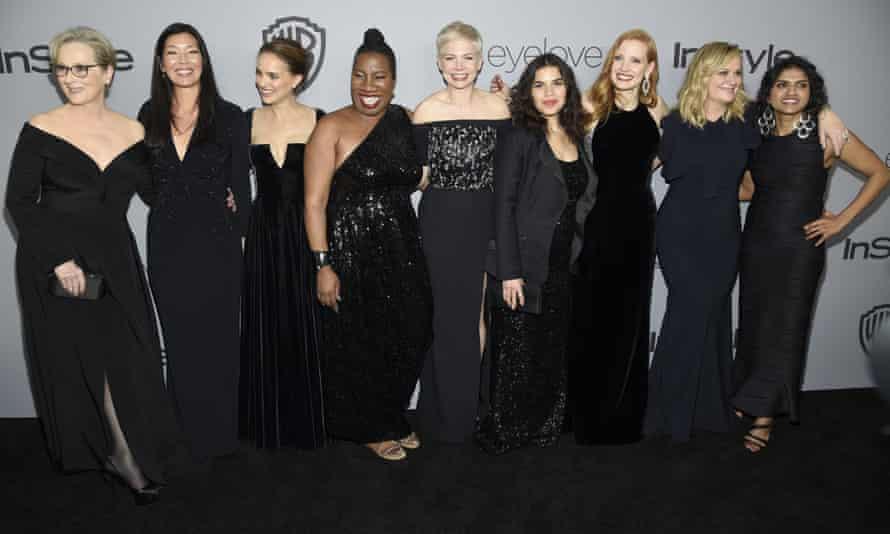 From left: Meryl Streep, Ai-jen Poo, Natalie Portman, Tarana Burke, Michelle Williams, America Ferrera, Jessica Chastain, Amy Poehler, and Saru Jayaraman arrive at the Golden Globes afterparty in Beverly Hills.