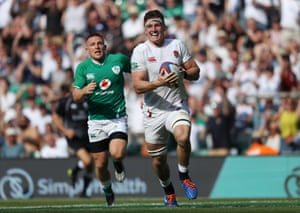 Tom Curry runs through to score another try for England.