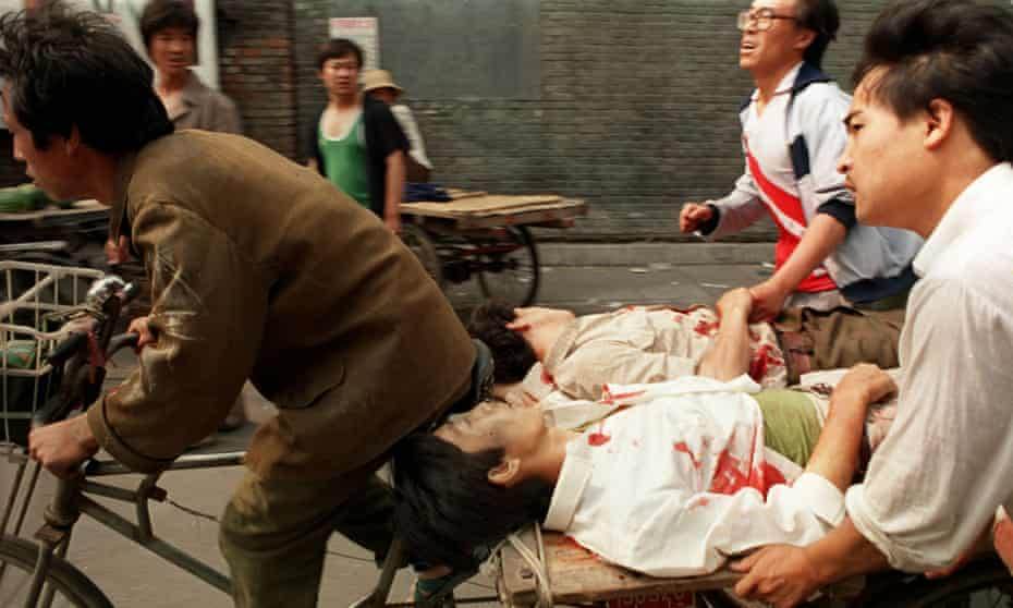 A rickshaw driver helps the wounded during Tiananmen Square protests in Beijing, 4 June, 1989.