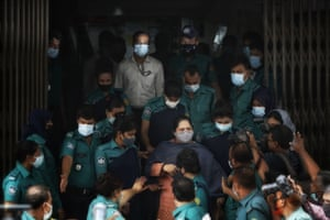 Police escort investigative journalist Rozina Islam to a court in Dhaka, Bangladesh on Tuesday.