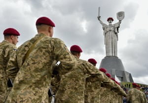 Soldiers in Kiev, Ukraine, march past the Motherland monument