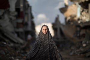 A Palestinian girl amid the rubble of al-Shejaiya district in Gaza City, which was heavily bombed by Israel during this year's conflict.