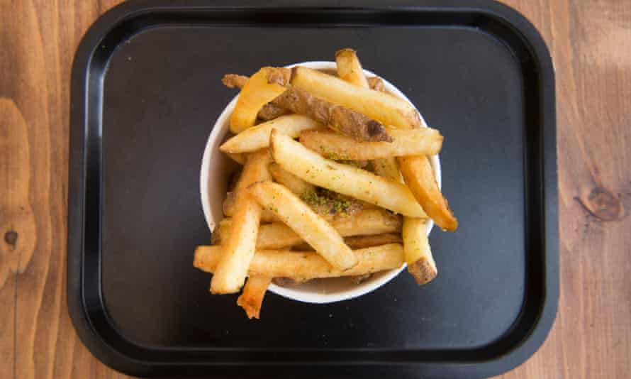 Rosemary salted chips on a plastic tray
