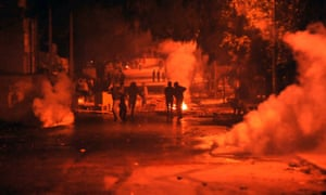 Tunisian security forces use teargas against protesters in Ettadhamen.