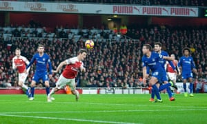 Laurent Koscielny scores with his shoulder to double Arsenal's advantage in the 2-0 victory over Chelsea at the Emirates Stadium.