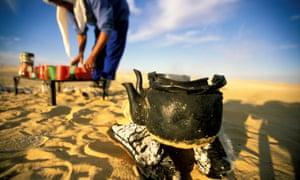 Preparing tea on a desert trek.