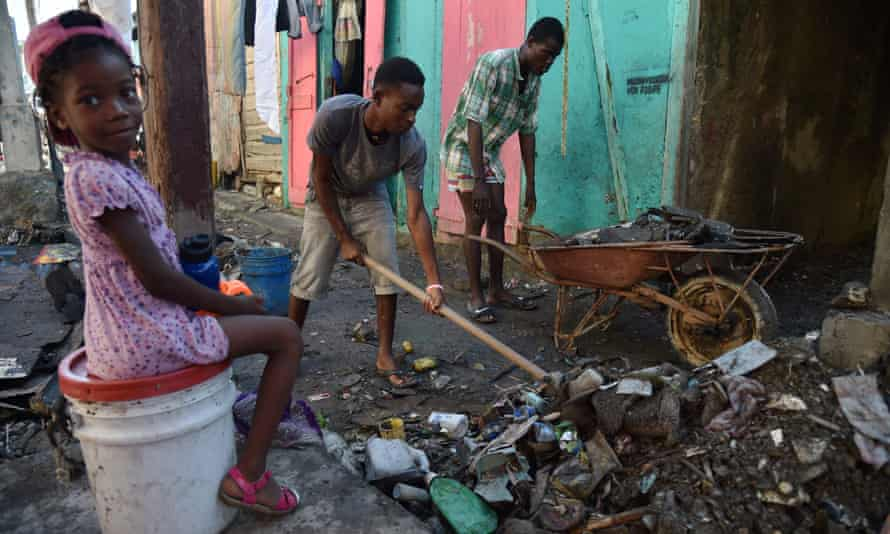 Residents clean debris left by the floods caused by Hurricane Matthew, in Jérémie, Haiti, 8 October