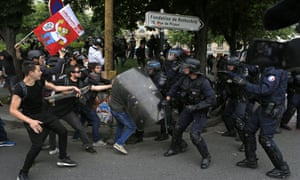 Riot police and protesters during a demonstration against the reforms in Paris.