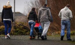People walk through a park in Glasgow