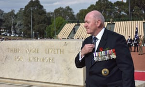 Australian governor general Peter Cosgrove walks past the Stone of Remembrance in Canberra.