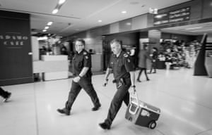 Members of the Victoria police transport unit quickly usher an organ, packed in ice, to a waiting police car. With sirens on, they will escort the organ to the airport, where it will be flown interstate for transplant. Once outside the body, organs have a limited lifespan, a matter of hours before they are no longer suitable for transplantation