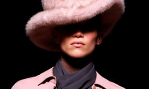 Model in pink hat.