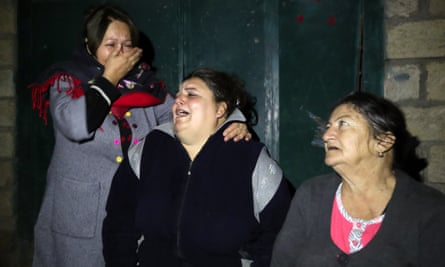 Local women react after the strike.