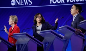 Kamala Harris makes a point flanked by Elizabeth Warren and Andrew Yang.