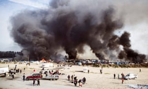 Smoke shrouds the Jungle in Calais, France
