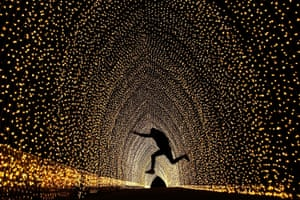 A visitor leaps inside the 'Cathedral of Light', part of Sydney's annual Vivid Festival of light, music and ideas.