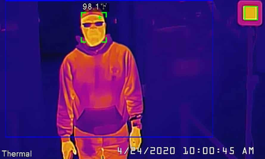 A Dahua thermal camera takes a man's temperature during a demonstration in San Francisco.