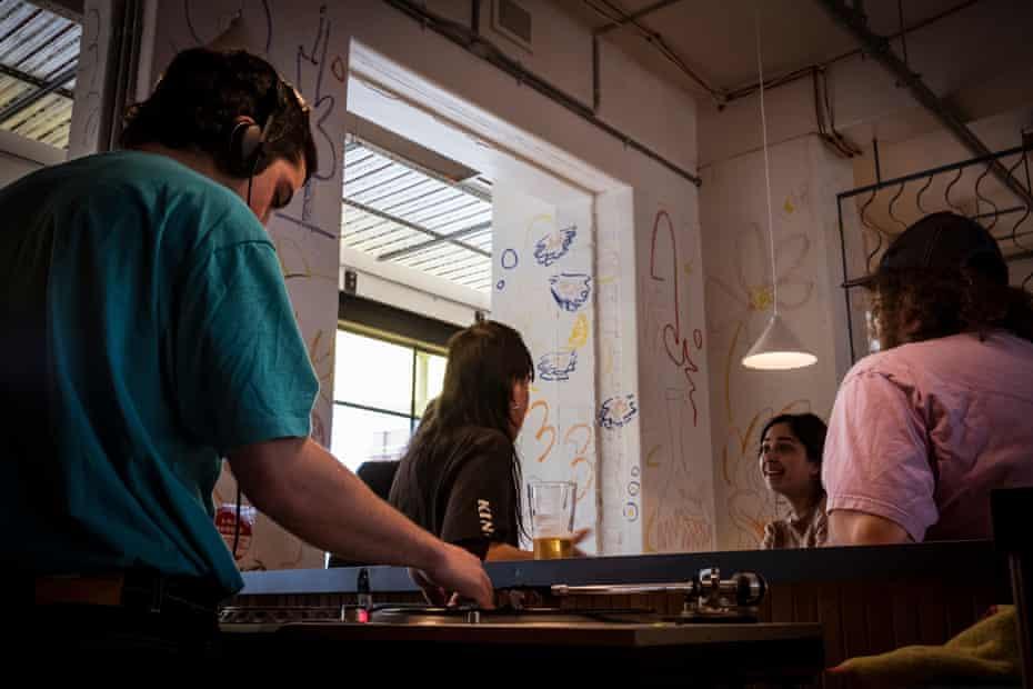 DJ Sandpit Alias, AKA Aidan Psaltis, starts a set at Hope St Radio's new wine bar and restaurant