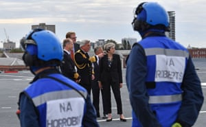 Prime Minister Theresa May talks with First Sea Lord Admiral Philip Jones as she tours ship