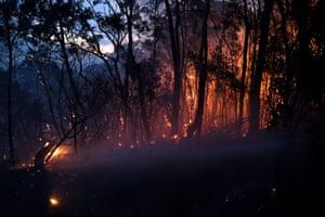 A bushfire burns close to homes on Railway Parade, Woodford