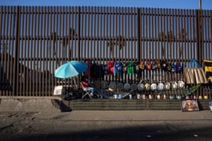 Mexicali, Mexico Street vendors use the border fence to display their items on the US/Mexico border