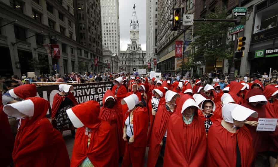 Women dressed as handmaids protest against US vice-president Mike Pence in Philadelphia, 23 July