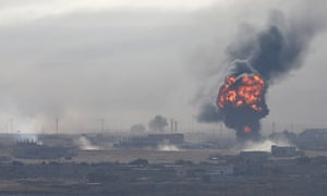An explosion in the Syrian border town of Ras al-Ayn, which Turkish forces were attempting to capture.