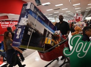 A man pushes a cart loaded with a very large television at a Target store jn Culver City, US