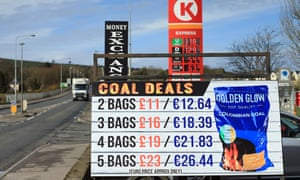 A sign displays the price of coal in sterling and euros at a petrol station in Northern Ireland