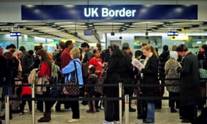 Travellers have their passports checked at London's Heathrow airport.