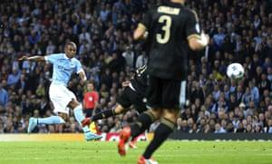 Fernandinho fires a shot at goal.