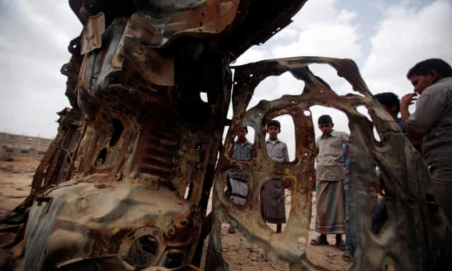 Boys gather near the wreckage of car destroyed by a US drone air strike targeting suspected al Qaeda militants in the southeastern Yemeni province of Shabwa.