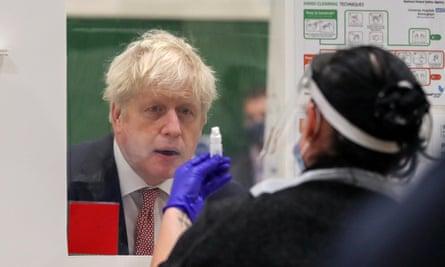 Boris Johnson watches Covid testing at De Montfort University in Leicester.