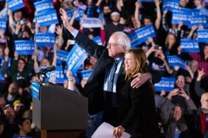 Bernie Sanders waves to the crowd with his wife Jane after speaking during a primary night watch party at Concord High School in Concord, New Hampshire.
