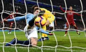 John Stones of Manchester City makes a goal-line clearance during a Premier League match against Liverpool