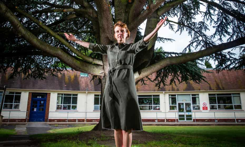 Maggie Carson, a nurse and lecturer, at Astley Ainslie with the atlas cedar she has befriended.