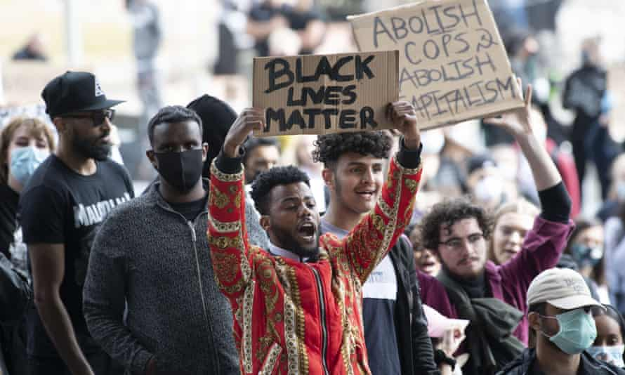 """A protestor holds up a sign saying """"Black Lives Matter"""" during a protest in Bute Park, Cardiff, on 6 June."""