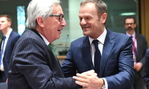The commission president, Jean-Claude Juncker, greets the president of the European council, Donald Tusk, in Brussels.