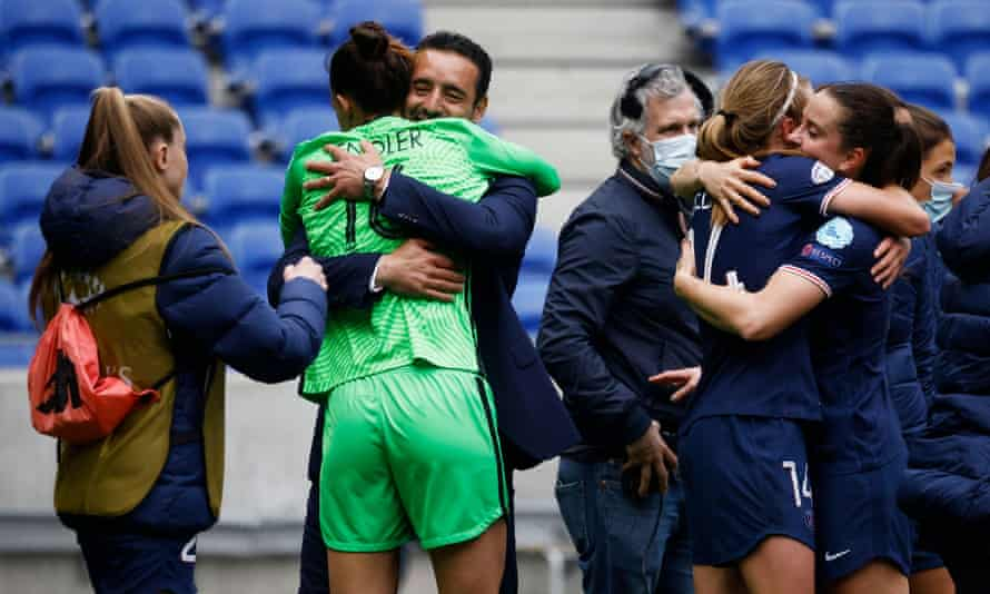 PSG women's coach Olivier Echouafni celebrates with Christiane Endler after they beat holders Lyon to reach the semi-finals of the Champions League.