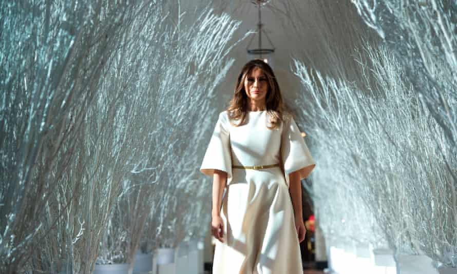 US First Lady Melania Trump walks through Christmas decorations in the East Wing as she tours holiday decorations at the White House in Washington, DC, on November 27, 2017.