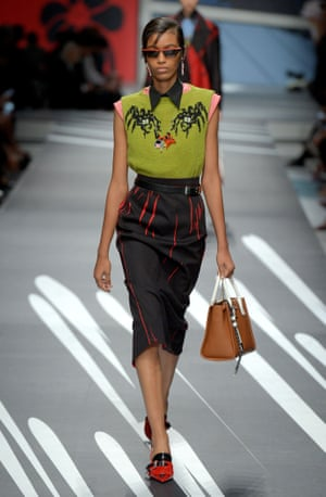 A model wears a pencil skirt with a boxy blouse.