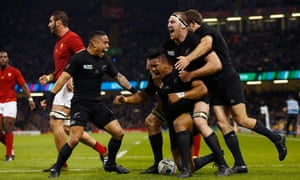 New Zealand players celebrate with double try scorer Julian Savea.
