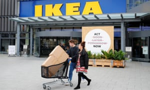 Couple leaving Ikea store with purchases