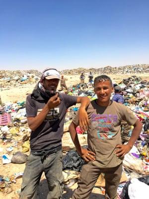 Syrian refugees Majid Al Ahli (L) and Nawras Sahasil (R) at Al Huseyniyat landfill in Mafraq